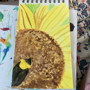 Unfinished watercolor of sunflower with bee